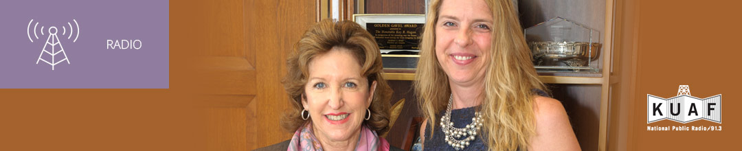 Photo of Kay Hagan and Jennifer Platt with KUAF logo and white sans-serif type in upper left on muted lavender background with radio icon
