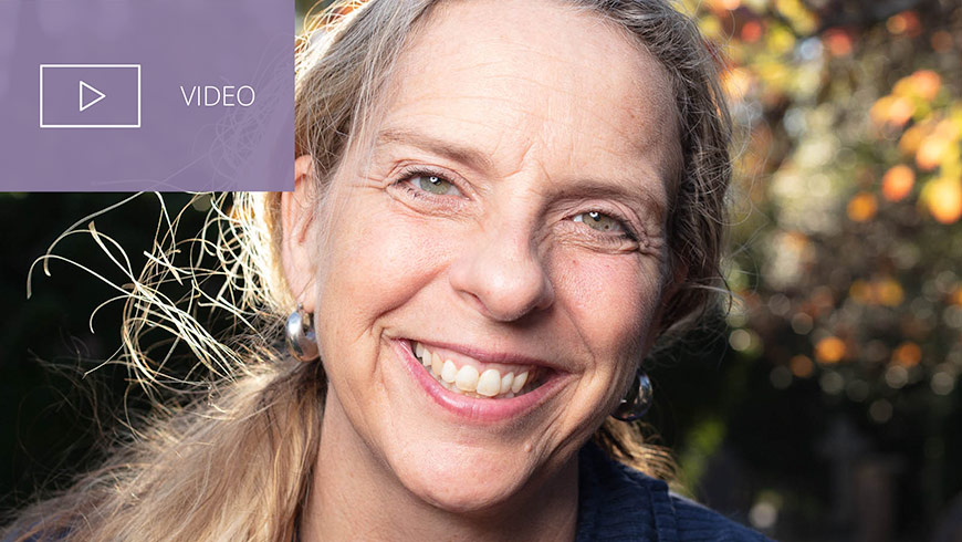 Photo Of Jennifer Platt And White Sans-serif Type In Upper Left On Muted Lavender Background With Video Icon