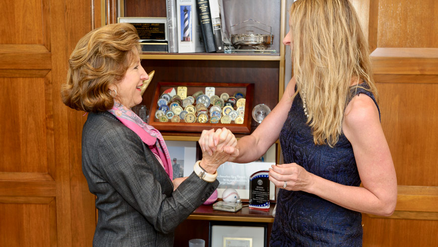 High Five Handshake Between Senator Kay Hagan And Dr Jennifer Platt, Cofounder TBC United, CEO, TickWarriors