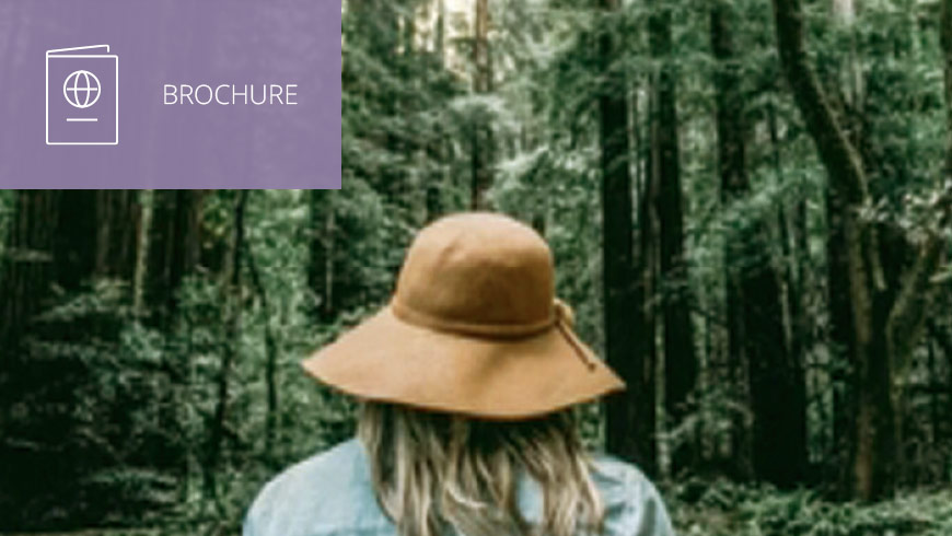 Photo of woman facing the forest wearing a hat and white sans-serif type to left on muted lavender background with brochure icon